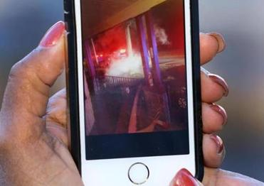 Grace Mehlado showed a picture she took of the fiery wreck from her front porch.